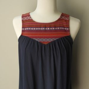 Navy tank with red tribal detail on top